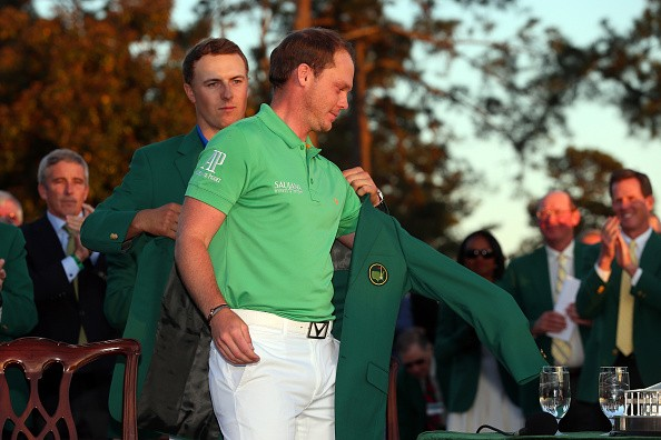 AUGUSTA, GEORGIA - APRIL 10: Jordan Spieth of the United States presents Danny Willett of England with the green jacket after Willett won the 2016 Masters Tournament at Augusta National Golf Club on April 10, 2016 in Augusta, Georgia. (Photo by Andrew Redington/Getty Images)
