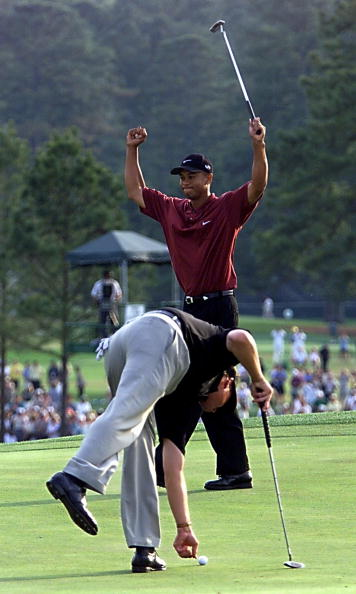 Tiger Woods (BACK) celebrates his winning birdie p