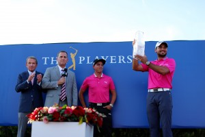 PONTE VEDRA BEACH, FL - MAY 15: Rickie Fowler (2ndR) of the United States presents the trophy to Jason Day (R) of Australia after Day won the final round of THE PLAYERS Championship at the Stadium course at TPC Sawgrass on May 15, 2016 in Ponte Vedra Beach, Florida. (Photo by Richard Heathcote/Getty Images)
