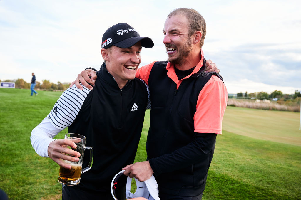 TARRAGONA, SPAIN - NOVEMBER 20: Rasmus Hojgaard of Denmark (L) and Benjamin Poke of Denmark (R) celebrates after both qualify on to the European Tour during day six of the European Tour Qualifying School Final Stage at Lumine Lakes Golf Course on November 20, 2019 in Tarragona, Spain. (Photo by Aitor Alcalde/Getty Images)